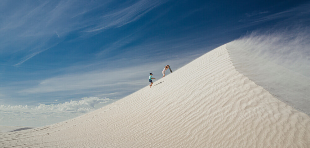 Discover Port Stephens - Sandboarding Surf the sand